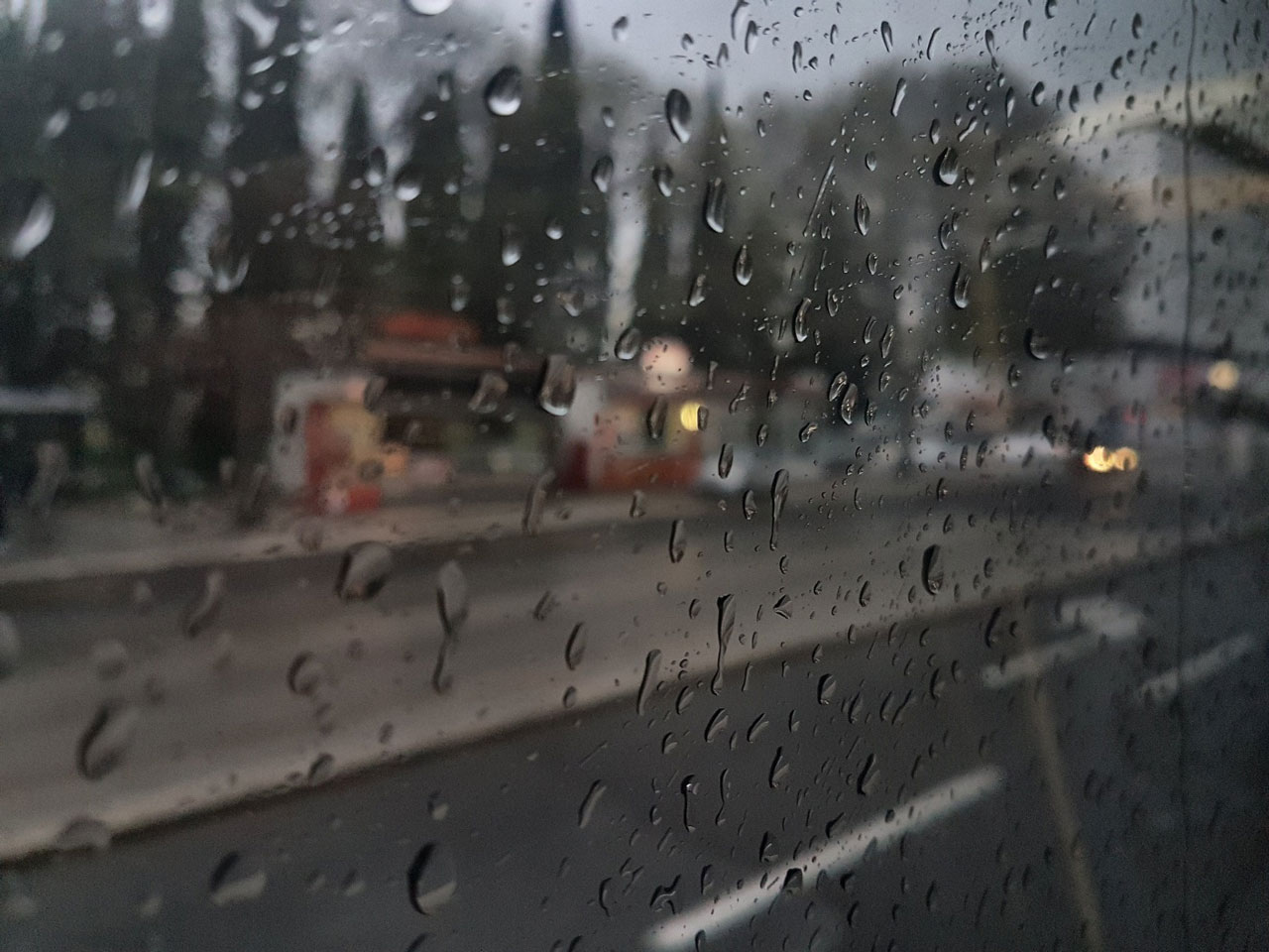 A reflective window, rainy day